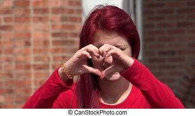 Cute Adorable Teen Girl Making Heart Shapes
