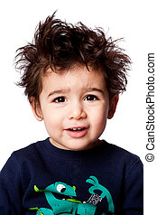 Cute adorable funny toddler boy facial expression with crazy hair, isolated.