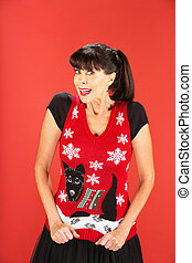 Cute adult female in ugly Christmas sweater - Front view on...