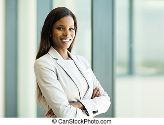 african american business woman with arms crossed in office