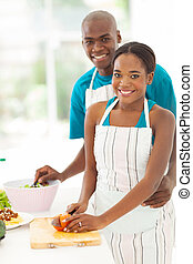 african american couple cooking healthy food