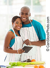 african american couple in home kitchen