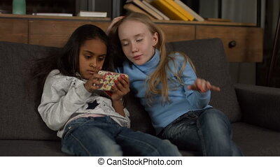 Cute african american girl playing with smartphone