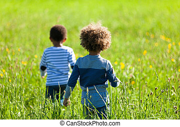 Cute african american little boys playing outdoor - Black people