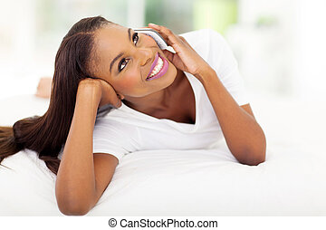 african american woman talking on mobile phone