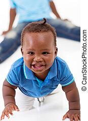 cute african baby boy crawling on floor - cute african...