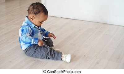 Cute african baby sitting on the floor