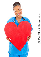 cute african doctor holding heart isolated on white...