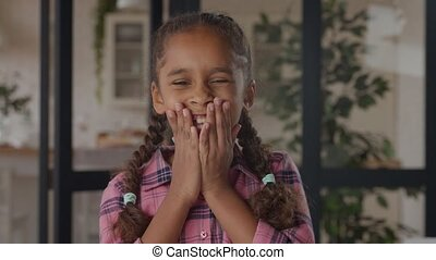 Cute african girl expressing positive emotions - Indoor ...