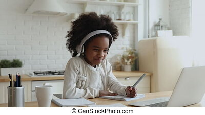 Cute african school girl elearning with online tutor at home...