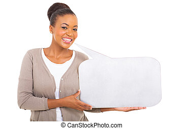 african woman holding speech bubble