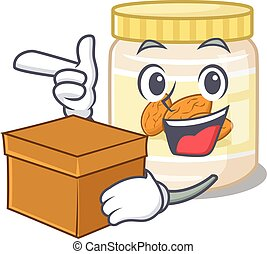 Cute almond butter cartoon character having a box