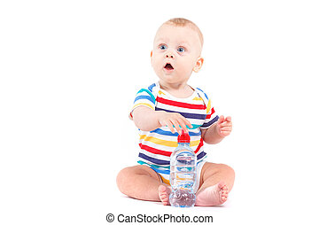 cute amazed little boy in colorful shirt with milk