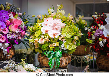 Cute and stylish wicker basket with beautiful and colorful flower composition