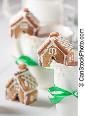 Cute and sweet gingerbread cottages with tasty chocolate for Christmas