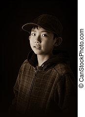 Cute Asian Boy in Sweater and Cap in Sepia Effect