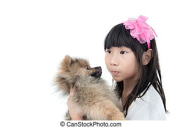 Cute Asian child with her happy doggy