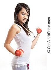 Cute asian filipino fitness woman exercising