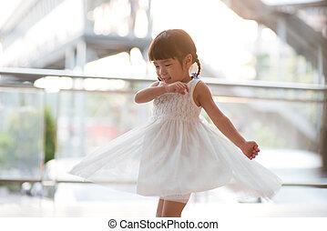 Cute Asian girl dancing