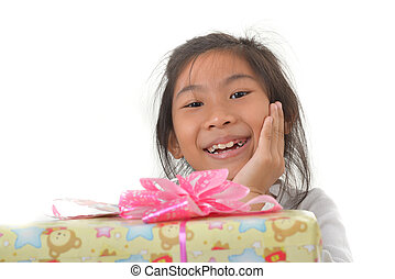 Cute Asian girl with gift on a white background