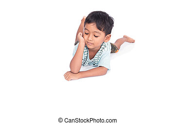cute asian little boy lying on the floor