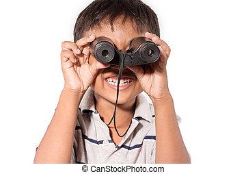 Cute asian little boy with binoculars