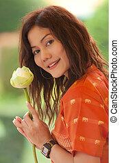 asian woman holding lotus flower