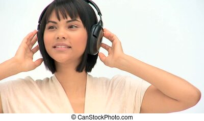 Cute asian woman listening to music