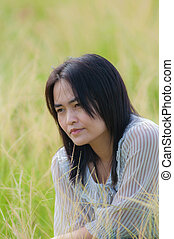 asian woman - Cute asian woman portrait in the grass field.