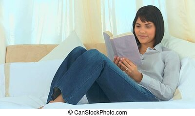 Cute asian woman reading a book
