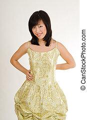Cute asian women in gold evening dress