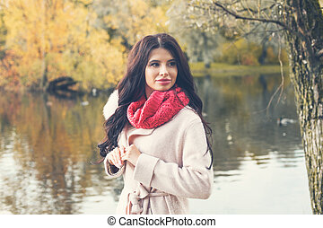 Cute autumn woman outdoors, fall season fashion portrait