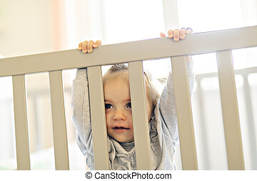 Cute baby baby on the baby room crib