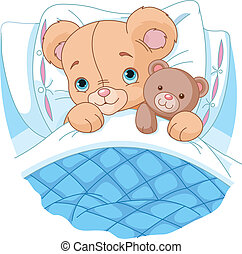Cute baby bear in bed