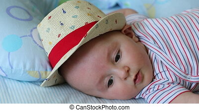 Cute Baby Boy Aged 5 Month Old With His Straw Hat