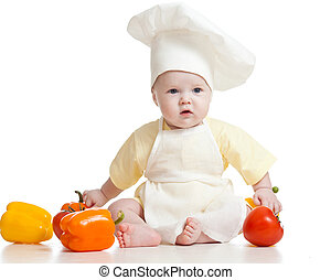 cute baby boy chef with healthy  food vegetables, isolated on white