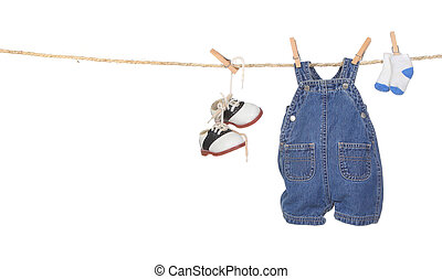 Cute Baby Boy Clothes Hanging on a Rope With Copyspace