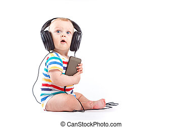 cute baby boy in colorful shirt with headphones