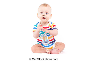 cute baby boy in colorful shirt with water