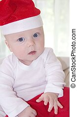 Cute baby boy in santa clause outfit