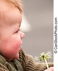 cute baby boy looking at copyspace