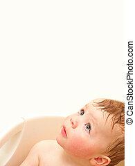 Cute baby boy looking up at copyspace