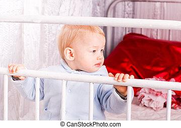 Cute baby boy on a bed playing - Cute happy baby boy on a...