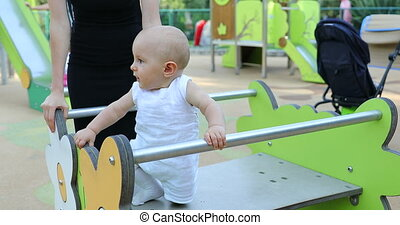 Cute Baby Boy Playing At Outdoor Playground