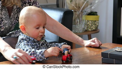 Baby Boy Playing With Toy Cars