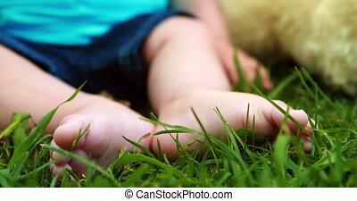 Cute baby boy sitting on the grass