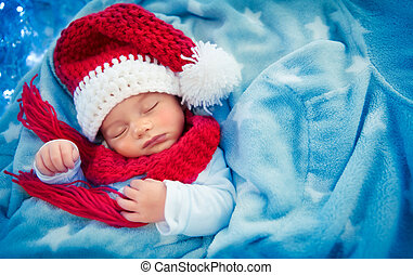 Cute baby boy sleeping in Santa hat - Portrait of a cute...