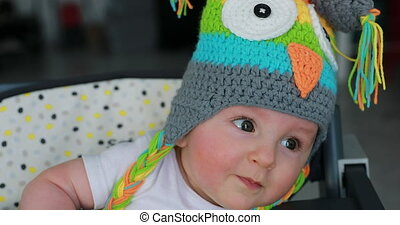 Cute Baby Boy With A Funny Wool Hat On The Head