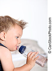 cute baby boy with bottle