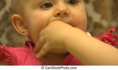 Cute Baby Chewing a Finger, First Teeth